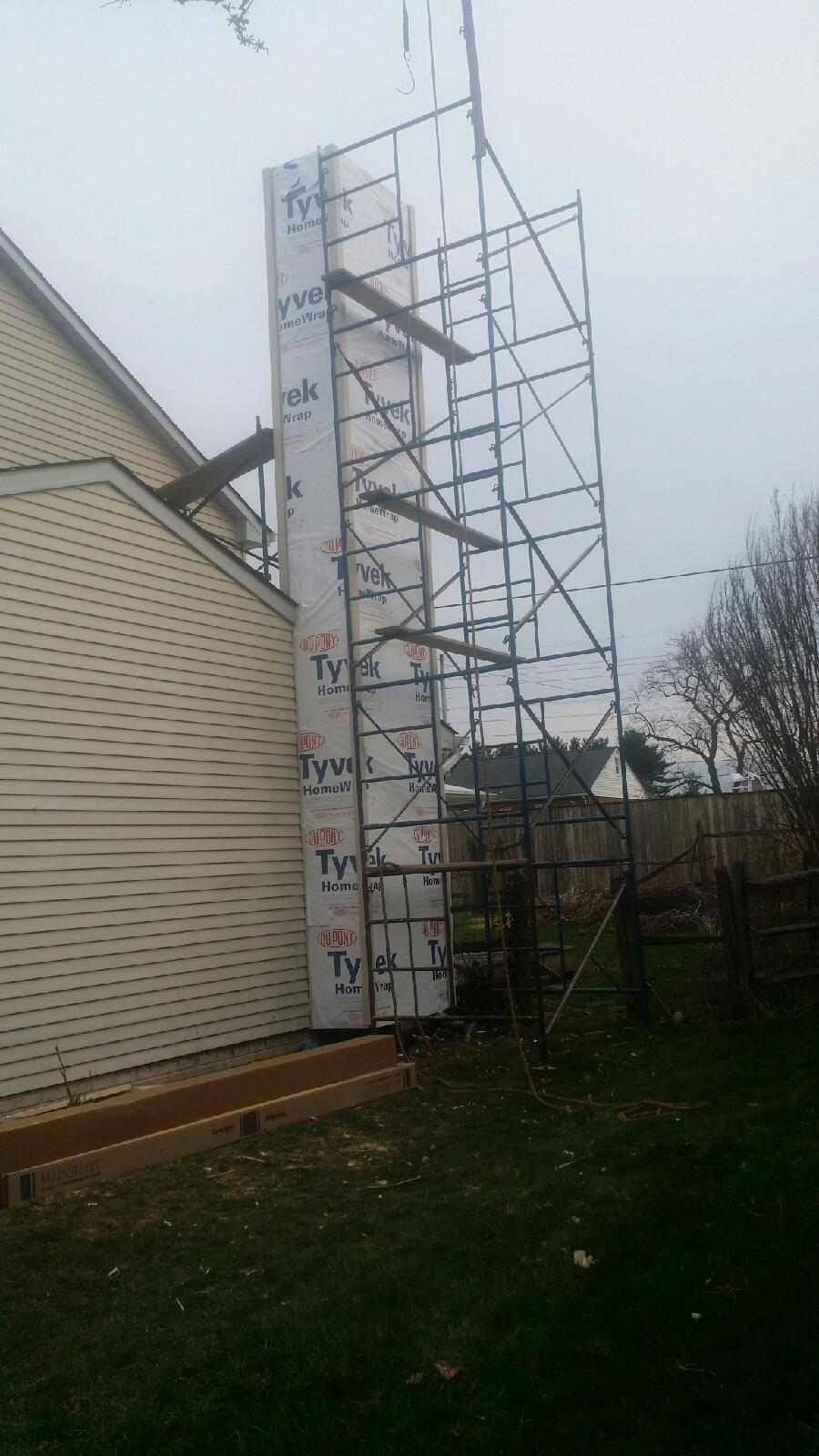 Chimney covered in Tyvek with scaffolding set up