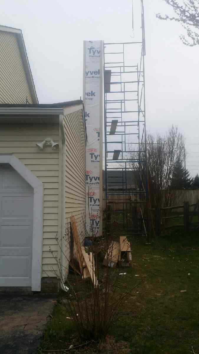 Scaffolding set up next to chimney