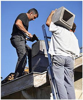 Men working on chimney