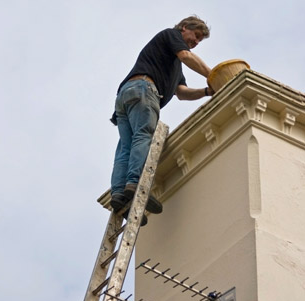 Man inspecting top of chimney