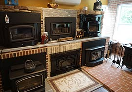 Showroom with wood stoves on wall